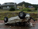 BOULDER, CO - SEPTEMBER 13: An overturned vehicle sits on Linden Road near S. Cedar Brook Rd. in Boulder Colorado Friday afternoon, September 13, 2013. (Photo By Andy Cross/The Denver Post)